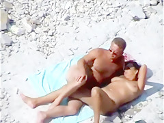 Mature couple beach play