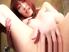 Sexy Asian Tokyo Neko spreads her pussy lips and fingers her clit