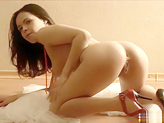 Sexy Vera Chan shows off her hot body and sticks her fingers in her hole