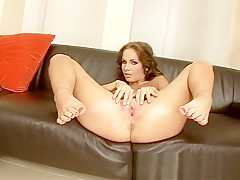 Ravishing brunette displays her sexy little feet and pleases herself