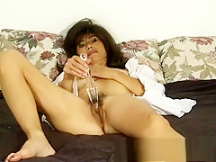 Irresistible Asian milf Song pleases her hairy snatch with a sex toy