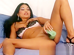 Stacked and exotic Tina peels off her sexy panties and fucks a dildo