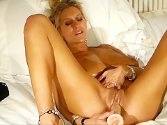 Oiled Up Blonde Fucks Her Dildos