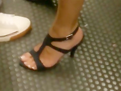 Candid sandals in metro