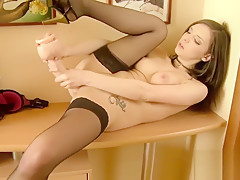 Stunning Maddy masturbates with a toy
