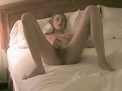 Skinny whore masturbates on web cam